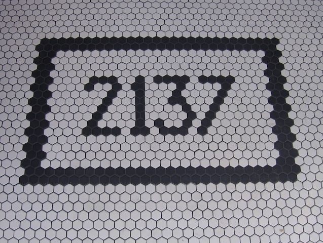 The House Number on the Floor Entryway